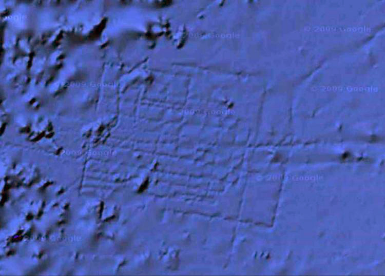"Daily Mail (6 feb 2012): ""After three years, Google Earth map has finally been updated to remove a gridlike pattern which sparked rumors that the underwater city of Atlantis had been found."" - Article"