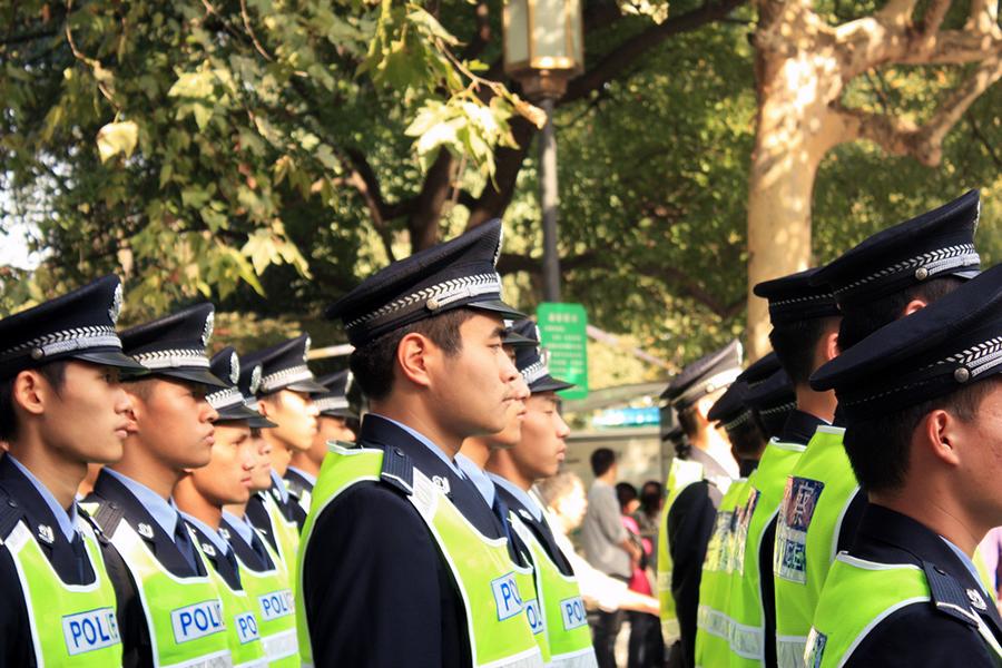 Poliser i staden Hangzhou. Foto: Colin J, CC BY-SA 2.0