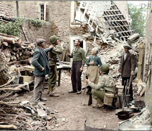 US soldiers greeting French citizens at St. Lo