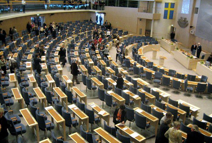 Riksdagen, plenisalen. License: CC BY-SA 3.0. Wikimedia Commons