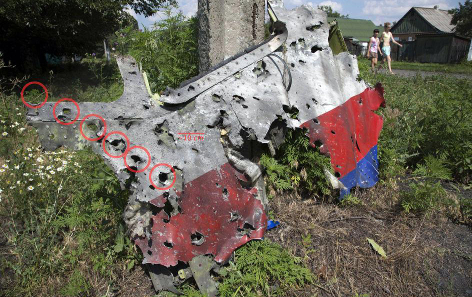 Flight MH17, bullet holes (Ukraine, 2014) - Photographer unknown